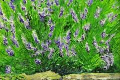 20 acrylic painting of lavendar flowers near a stone wall.