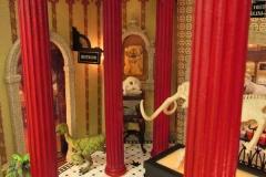 45c detail of miniature room sculpture of museum-like room with tiled floor displaying animal skeletons.