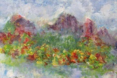 57 light and colorful acrylic painteing of mountains above a field of flowers.