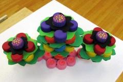 73a bright plastic flower soft sculptures.