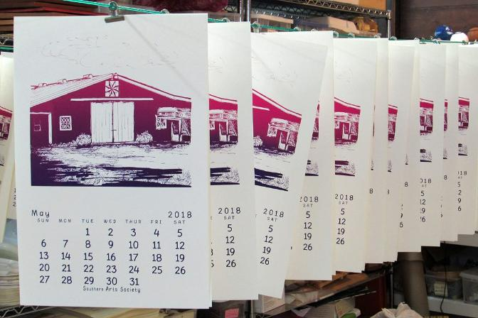 row of silkscreened May 2018 calendars hanging to dry