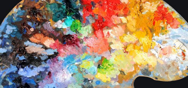 artist palette covered in layers of paint colors