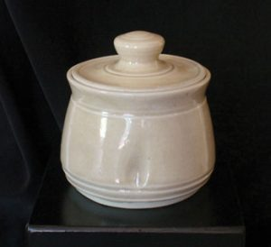 white whell-turned pottery jar with lid