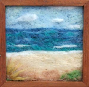 seascape created in wool by artist Tammy LaFitte