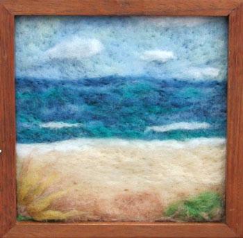 seascape created in wool by artist Tammy LaFitte