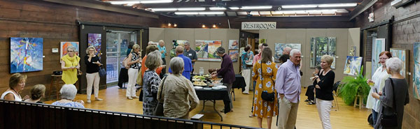People attending the reception for artist Anne Harkeness exhibit