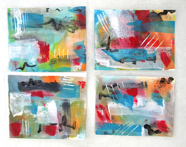 four abstract colorful paintings