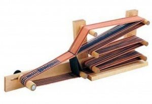 Inkle loom with thread.
