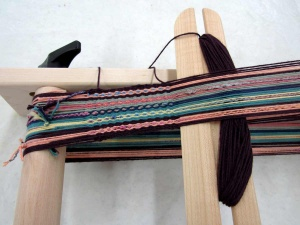 Inkle loom up close with thread.