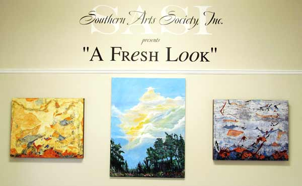 Southern Arts Society Inc presents A Fresh Look entrance with three paintings.