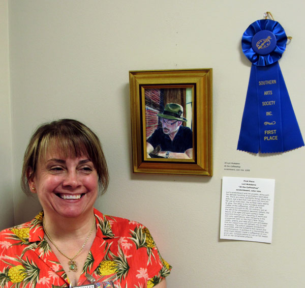 """Artist Lori McAdms wins first place for her scratchboard and ink painting / drawing At the Coffeeshop""""."""