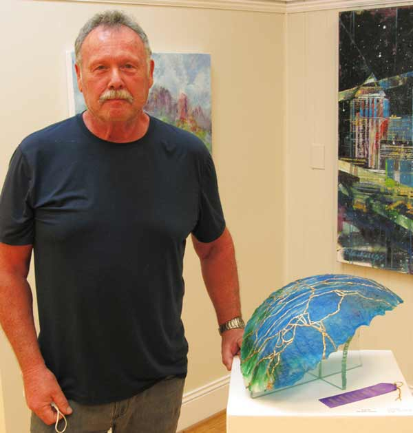 Artist Fred Mead in front of his merit award-winning artwork at Southern Arts Society's Nature Reconsidered 2021 art exhibit.