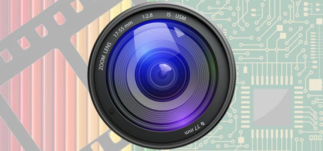 camera lens with film and digital motherboard background
