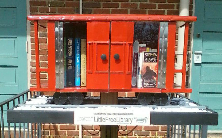 books for free little library inside miniature red caboose