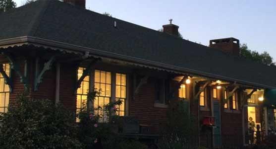 Southern Arts Society depot at night.